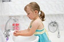 child washing their hands