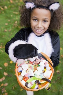little girl with Halloween candy
