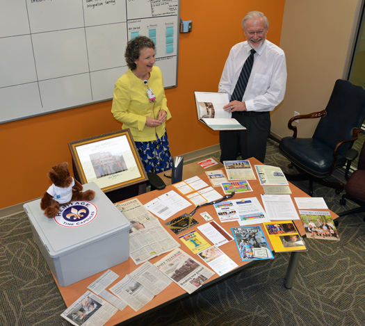 Ellen Hansen, COO and CNO along with John Boyd, MD, CEO look through items to be placed in the time capsule.